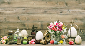 Easter decoration with pink tulip flowers and colored eggs Royalty Free Stock Photo