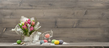 Easter decoration with pink tulip flowers and eggs Royalty Free Stock Photos