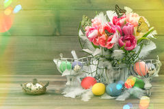 Easter decoration with pink tulips, butterflies and eggs. Light Stock Photo