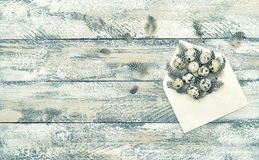 Easter decoration quail eggs wooden background Vintage toned Royalty Free Stock Photos