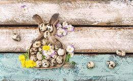 Easter decoration rabbit eggs pansy flowers. Easter decoration rabbit with eggs and pansy flowers on wooden background stock photography