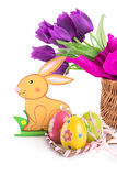 Easter decoration with rabbit, eggs and tulips Stock Photo