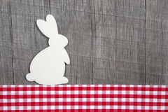 Easter decoration with a rabbit on a grey wooden background with Royalty Free Stock Photo