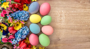 Easter decoration with spring flowers and colored eggs. Holidays Royalty Free Stock Image