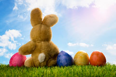 Easter decoration with sugar rabbits or bunny and eggs and blue sky Royalty Free Stock Photos