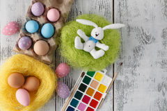Easter decoration on table with pastel color eggs Royalty Free Stock Image