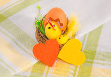 Easter decoration and three colorful  felt hearts on cotton napk Stock Photos