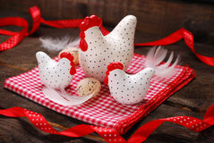 Easter decoration with three white hens on wooden background Royalty Free Stock Photos
