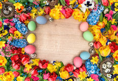 Easter decoration with tulips, narcissus, hyacinth flowers and c Royalty Free Stock Images