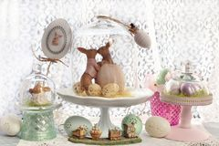 Easter decoration under glass dome on the window sill Royalty Free Stock Images