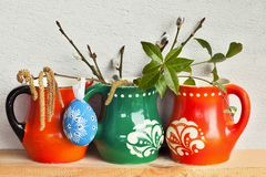 Easter decoration with variegated mugs Royalty Free Stock Photo
