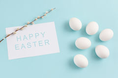 Easter decoration, white eggs and willow twig on a light blue ba Stock Image