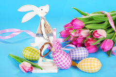 Easter decoration with wooden bunny and eggs Royalty Free Stock Photos