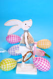 Easter decoration with wooden bunny and eggs Stock Photography