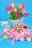 Easter decoration with wooden bunny and fresh tulips Royalty Free Stock Photography