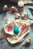 Easter decoration - wooden egg on fabric napkins, with cotton br Royalty Free Stock Photo