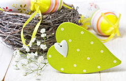 Easter decoration with  wooden heart Royalty Free Stock Photo