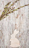 Easter decoration with wooden rabbit and catkins Royalty Free Stock Images