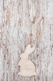 Easter decoration with wooden rabbit on old wood Royalty Free Stock Photos