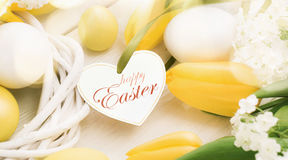 Easter decoration with yellow tulips Stock Photos