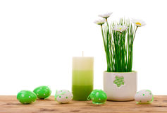 Easter decorations-  candle, eggs and flower in pot. Royalty Free Stock Photos