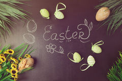 Easter decorations on chalkboard. View from above Stock Photo
