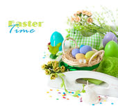 Easter decorations. With colorful eggs and funny candles on a white background royalty free stock images