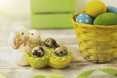 Easter decorations with Easter eggs, ceramic bunnies and ribbons.  stock photos