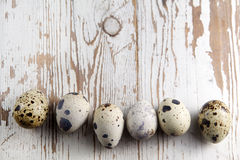 Easter decorations. Eggs in nests on wood Stock Images