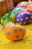 Easter decorations - eggs with painted flowers on the  tabletop Stock Photos