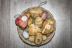 Easter decorations. Hearts and eggs in a basket royalty free stock photography