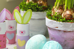 Easter decorations homemade bunnies eggs flowerpots. Easter decorations homemade. Bunnies, easter eggs and flowerpots made at home by children royalty free stock photo