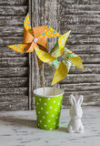 Easter decorations - homemade paper pinwheels and ceramic Easter Bunny Royalty Free Stock Images