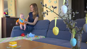 Easter decorations. Mother with baby at home. 4K stock video footage