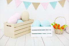 Easter decorations in pastel colors. In white room. Voxes with eggs royalty free stock images