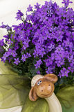 Easter decorations with purple flowers,green chiffon and funny Royalty Free Stock Image