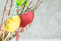 Easter decorations on pussy willow. Copy space Royalty Free Stock Images