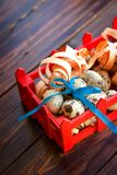 Easter decorations. Quail eggs with bow in box Stock Images