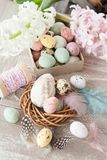 Easter decorations on wooden background. Easter decorations on a rustic wooden background stock photo
