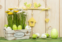 Easter decorations - wooden box with flowers and eggs. Stock Image