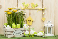Easter decorations - wooden box with flowers and eggs. Stock Images