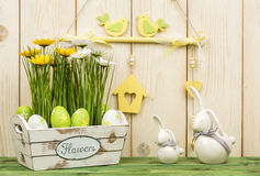 Easter decorations - wooden box with flowers, eggs  and bunnies. Stock Images