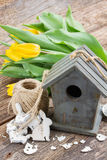 Easter decorations with yellow tulips Royalty Free Stock Photography