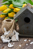 Easter decorations with yellow tulips Stock Images
