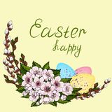 Easter decorations from young willow branches, decorated with multicolored Easter eggs and pink cherry flowers with a wish for a stock illustration