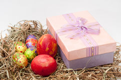 Easter decorative chocolate and chicken eggs in the nest with pi Royalty Free Stock Photos