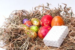 Easter decorative chocolate and chicken eggs in the nest with wh Stock Photography