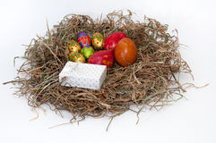 Easter decorative chocolate and chicken eggs in the nest with white gift box stock photography