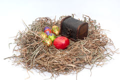Easter decorative chocolate and chicken eggs in the nest with wo Stock Image