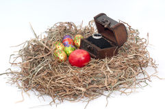 Easter decorative chocolate and chicken eggs in the nest with wo Royalty Free Stock Photo
